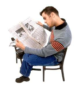 Leveson inquiry: man reading newspaper